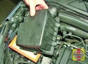 Illustration of step:  Undo the retaining screws and lift off the air cleaner cover  - step 5
