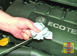 Illustration of step:  Using a clean rag or paper towel remove all oil from the dipstick - Car care - step 11