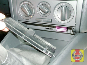 Illustration of step: Unclip the panel beneath the heater controls to access the diagnostic socket - step 2