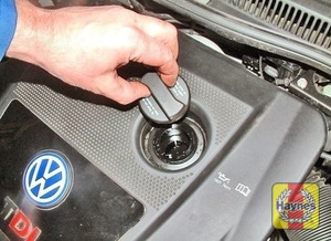 Illustration of step:  Oil is added through the filler cap aperture - Car Care - step 13