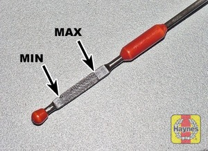 Illustration of step:  Note the level on the end of the dipstick, which should be between the upper (MAX) and lower (MIN) mark - Car care - step 12