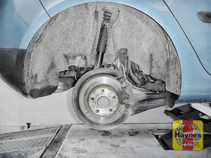Illustration of step: As with the fronts, check for wear in the wheel hub bearings by grasping the wheel and trying to rock it - step 9