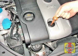 Illustration of step:  The dipstick is often brightly coloured for easy identification (see Underbonnet check points for exact location) - Car care - step 11