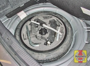 Illustration of step:  The spare wheel and tools are stored in the luggage compartment - step 3