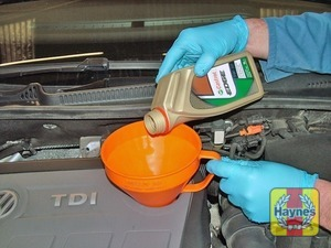 Illustration of step:  Top-up the level; a funnel may help to reduce spillage - Car care - step 14