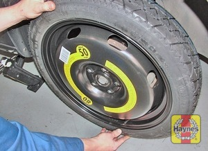 Illustration of step:  Fit the spare wheel, and screw in the bolts - step 9