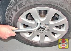 Illustration of step:  Use the wheel brace to slacken each wheel bolt by half a turn - step 5