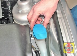 Illustration of step:  a The screenwash fluid reservoir is located on the left-hand side of the engine compartment, behind the headlight - Washer fluid level - step 34