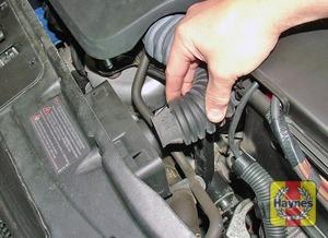 Illustration of step:  Unhook the inlet hose  - 1.2 litre engines - step 3