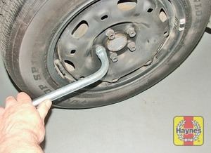 Illustration of step:  Slacken each wheel bolt by half a turn (using the special splined adapter for the anti-theft bolt) - step 5