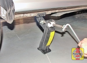 Illustration of step:  Locate the jack below the reinforced point on the sill (don't jack the vehicle at any other point of the sill) and on firm ground, then turn the jack handle clockwise until the wheel is raised clear of the ground - step 6