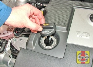 Illustration of step:  Oil is added through the filler cap aperture - Car care - step 14