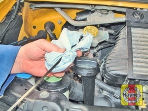 Illustration of step:  Using a clean rag or paper towel remove all oil from the dipstick - Vehicle care - step 10