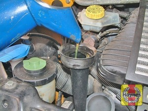 Illustration of step:  Oil is added through the filler cap - Vehicle care - step 12