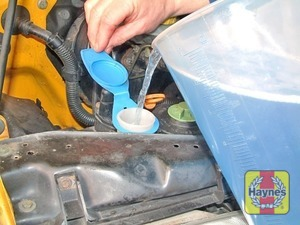 Illustration of step:  When topping-up the reservoir a screenwash additive should be added in the quantities recommended on the bottle - Screen washer fluid level - step 40