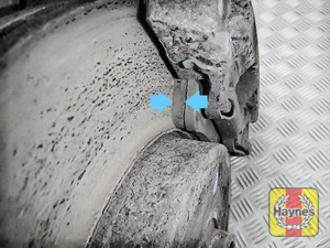 Illustration of step: Now locate the brake pads - there are two, one on each side of the disc - step 5