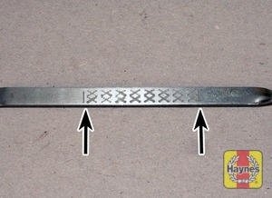 Illustration of step:  Note the oil level on the end of the dipstick, which should be in the hatched area between the upper (MAX) mark and lower (MIN) mark - Car care - step 12