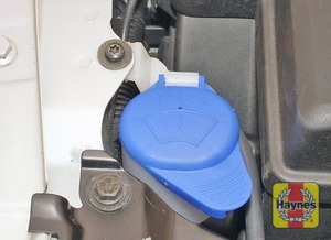 Illustration of step:  The washer fluid reservoir filler is located at the front right-hand side of the engine compartment (the reservoir itself is actually located under the car) - Washer fluid level - step 39