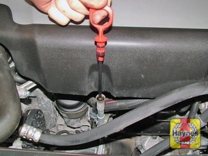 Illustration of step:  On most models, the dipstick is located on the front of the engine (see Underbonnet check points for exact location) - Car care - step 10