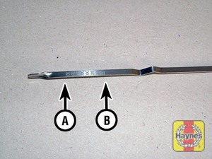 Illustration of step:  Note the oil level on the end of the dipstick (XC60 model shown) which should be between the upper mark (B) and lower mark (A) - Car care - step 12