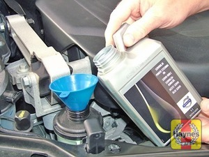Illustration of step:  If topping up is necessary, wipe around the filler cap, remove the cap and top up with Volvo power steering fluid M2C204-A - Safety first! - step 37