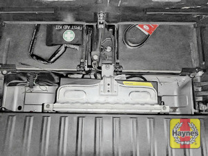 Illustration of step: Locate the battery, it is located under the boot floor in this vehicle - step 2