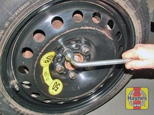 Illustration of step:  Fit the spare wheel, then insert each of the wheel bolts and tighten them moderately using the wheelbrace - step 7