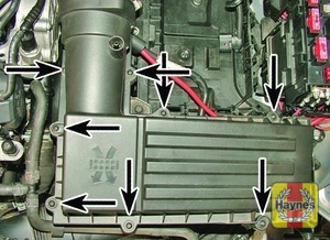 Illustration of step:  Undo the air filter cover bolts (arrowed)  - step 2