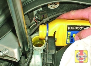 Illustration of step:  On completion, securely refit the cap and wipe away any spilt fluid -  	Safety first! - step 25