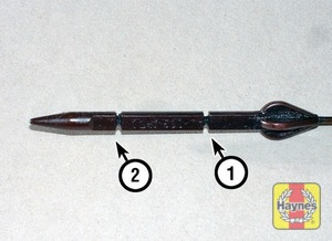 Illustration of step:  Note the oil level on the end of the dipstick, which should be between the upper maximum mark (1) and lower minimum mark (2) - Car care - step 12