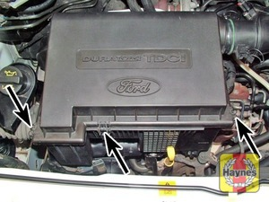 Illustration of step:  Release the spring clips (arrowed) securing the air cleaner cover to the air cleaner housing  - Front-wheel drive vehicles - step 7