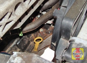 Illustration of step:  The dipstick is brightly coloured yellow and is located on the front of the engine (see Underbonnet Check Points for exact location) - Car Care - step 12