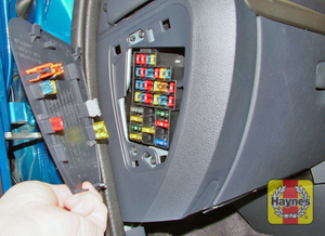 Illustration of step: Open the passenger's side fascia panel to access the main fusebox - step 1
