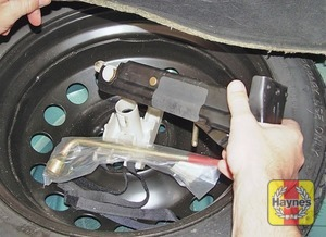 Illustration of step:  The spare wheel and tools are stored in the luggage compartment under the carpet - step 2