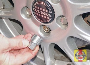 Illustration of step:  On models with alloy wheels, a Volvo socket may be needed to remove the security bolt – the socket should be in the glovebox or toolkit - step 5