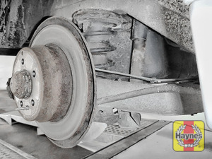 Illustration of step: Take a good look around the brake system and the suspension arm, checking for any leaks - step 13