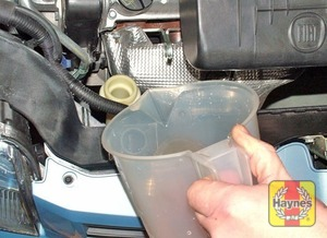 Illustration of step:  Add a mixture of water and antifreeze to the expansion tank until the coolant level is halfway between the level marks - Car care - step 18