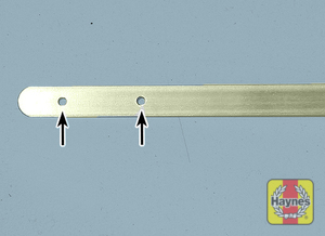 Illustration of step:  4 The oil level should be between the two holes in the dipstick  - step 5
