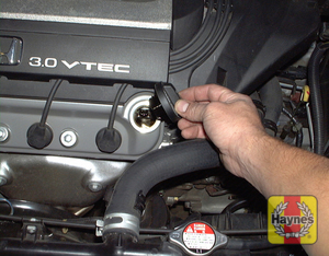 Illustration of step:  6 Remove the threaded cap from the valve cover to add oil - Engine oil - step 7