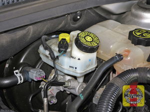 Illustration of step:  3 The brake fluid level should be kept between the MIN and MAX marks on the translucent plastic reservoir; with manual transaxles, the brake fluid reservoir is connected to the clutch master cylinder by a hose  - Brake and clutch fluid - step 23