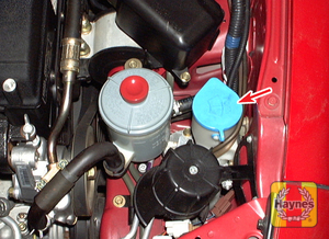 Illustration of step: 1 The windshield washer fluid reservoir (arrow) is located at the left front corner of the engine compartment  - Engine coolant - step 23