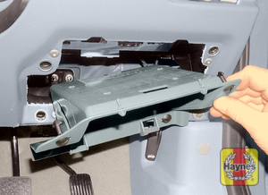 Illustration of step: Undo the fasteners, remove the drivers side storage compartment … - step 1