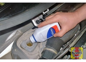 Illustration of step:  Carefully add fluid, taking care not to spill it onto the surrounding components - Safety first! - step 29