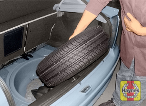 Illustration of step:  The spare wheel is beneath a cover in the luggage compartment on Astra models - step 4