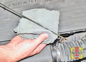 Illustration of step:  Using a clean rag or paper towel, wipe all the oil from the dipstick - Car Care - step 10