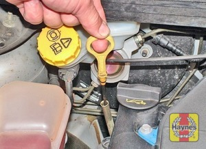 Illustration of step:  The dipstick is located in a tube at the front of the engine on all engines except the 1 - Car Care - step 9