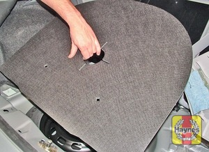 Illustration of step:  The spare wheel and tools are located in the luggage compartment, under boot carpet - step 2