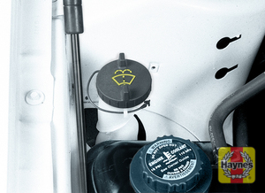 Illustration of step:  22 Windshield washer fluid is stored in a plastic reservoir located under the right front (passenger's side) fender, directly behind the coolant expansion tank  - Brake fluid - step 24
