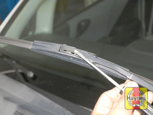 Illustration of step:  5 Lift the arm assembly away from the glass for clearance, press on the release lever, then slide the wiper blade assembly out of the hook in the end of the arm - Windshield wiper blades - step 7