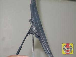 Illustration of step:  5a Press on the release tab and push the blade assembly down out of the hook in the arm  - Windshield wiper blades - step 8